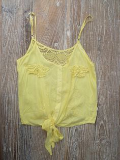 adorable yellow lace tank...would look gorgeous with some ripped jean shorts