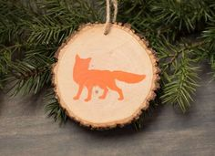 Save your Christmas tree by using crosscut wood sections from the trunk and turning into DIY ornaments for next year's decorations