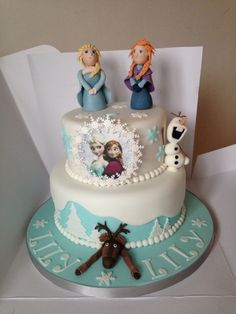 Two tier Frozen cake including Sven, Olaf, Anna and Elsa