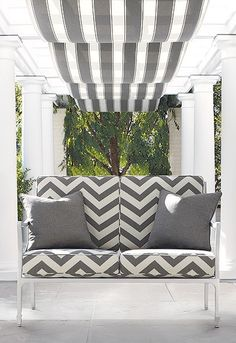 Love the Chevron cushions. and the striped awning...perfection...
