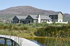 Known for his contemporary Cape vernacular style, architect Simon McCullagh is one of the preferred architects selected to work on the Lake Michelle eco-estate in Noordhoek. Local Architects, Building A New Home, Architect House, Plan Design, Outdoor Spaces, House Plans, New Homes, Cabin, Contemporary