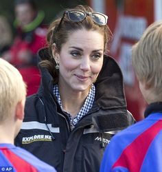13 April 2014:  The Duchess of Cambridge talks to students from Arrowtown School after stepping off the high-powered boat
