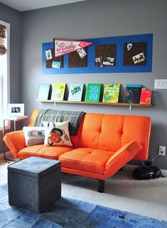 this orange futon is amazing * also, i love the trick of painting a block of color to act as a 'frame'