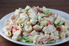 Chicken Bacon Ranch Pasta  1lb medium pasta shells  2 boneless skinless chicken breasts (cooked and shredded or diced)  ½ cup tomatoes (seeded and diced)  ½ cup green onions (sliced)  1 (8 ounce) block mozzarella cheese (diced)  1lb bacon (cooked until crispy and crumbled)  1 cup mayonnaise  1 cup ranch salad dressing  salt and pepper (to taste)