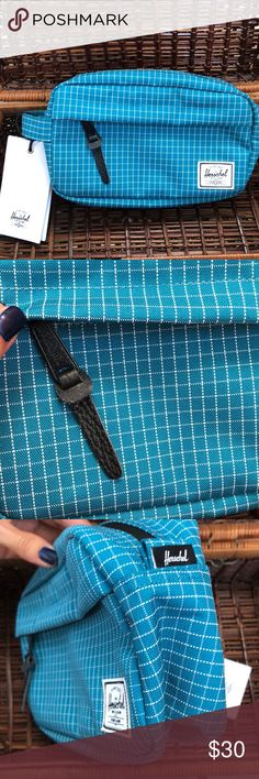 "{Herschel} travel bag Herschel Supply toiletries bag in Ocean Grid print. Zipper closure, internal mesh sleeve, front zippered pocket, pebbled leather pull, signature liner, classic woven label. 9""x5""x3"" NWT. Excellent condition. Clean. Authentic. Make an offer or bundle & save.   [btq summer travel essential basic aqua marine greenish blue-green turquoise sea water mermaid surf school college gym studio storage carry-on flight compact makeup cosmetic canvas wallet urban uo glasses case…"