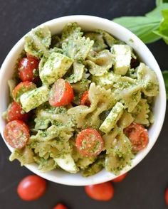 Coat it and some fresh mozzarella in a homemade pesto. | 17 Of The Most Delicious Things You Can Do To Bowtie Pasta