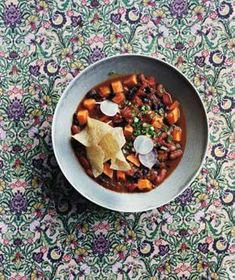 Slow-Cooker Vegetarian Chili With Sweet Potatoes This spicy chili is bursting with so many filling ingredients, including peppers, black beans, and tomatoes, you won't even miss the meat.