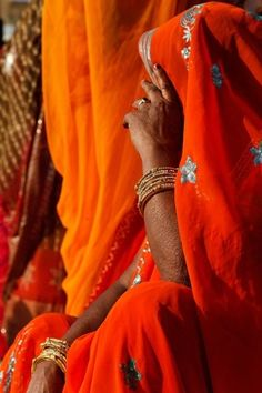Portrait of a woman in a bright orange sari during the Mewar Spring Festival, at Gangaur Ghat next to Lake Pichola / India Goa India, Orange You Glad, Orange Is The New, Saris, Namaste, Amazing India, Color Naranja, Spring Festival, Orange Crush