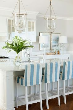 slipcovered barstools...House of Turquoise: Verandah House