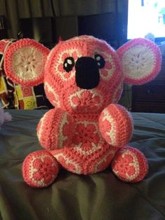 This is a crochet pattern for a stuffed African Flower Koala. Completed, it stands approximately 18 inches tall and is about one foot wide. Note: This listing is NOT for a completed item.