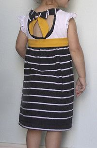 2 Tee Tie-Back Dress - a 2 Tee Tie-Back Dress for your girl. This tutorial delivers an easy-to-make dress that not only upcycles your outgrown clothes,  Read more at http://www.allfreesewing.com/Sew-for-Kids/2-Tee-Tie-Back-Dress#ZAYGLRUjLoCehHjY.99