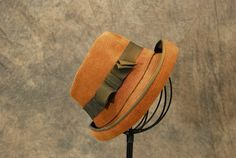 50s designer Elsa Schiaparelli wool felt hat. Brown wool that has been stitched all over to give the illusion of ribbed corduroy. Brown ribbon band. Rolled brim.
