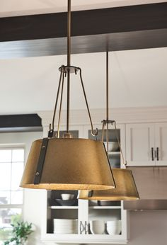 The Hinkley Cartwright pendant collection captures a modern farmhouse aesthetic with its minimalist silhouette enriched by exquisite details and rich finishes. Contrasting straps are enhanced by bold rivets while robust hooks add a masculine elegance. Kitchen Lighting Fixtures, Pendant Light Fixtures, Pendant Lighting, Bronze Chandelier, Chandelier Ceiling Lights, Kitchen Chandelier, Chandeliers, Shop Lighting, Lighting Design