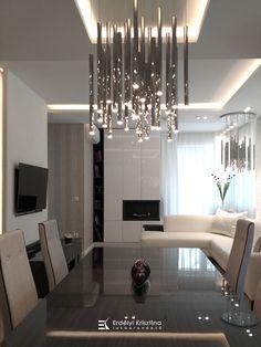 Visszafogott színvilágú felületek, csillogó króm lámpák jellemzik ezt az otthont. A modern geometrikus vonalvezetésű bútorok és lámpák, a fényes és matt felületek játékának összhatása megnyugtató, otthonos, de mégis elegáns hangulatot teremt. Tervező/Designer: Erdélyi Krisztina, www.erdelyikrisztina.hu #elegans#exkluziv#modern#home#design#interior#erdelyikrisztina#lakberendezo#belsoepitesz Chandelier, Ceiling Lights, Lighting, Modern, Home Decor, Elegant, Candelabra, Trendy Tree, Decoration Home