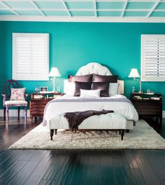 Opposites attract. Pretty purple accents with bold, bright teal walls creates a vibrant yet zen-like space. They were destined to be perfect for a bedroom. Take a spin on the color wheel and find your next statement color palette by using opposites. For tips like this and more home decor ideas, check out Design Meet Style.