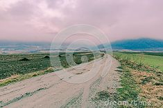 Photo about Misty autumn foggy morning to the mountains landscape with pink clouds and fog. Image of destination, morning, road - 107027865 Foggy Morning, Pink Clouds, Mountain Landscape, Country Roads, Autumn, Mountains, Image, Fall Season, Fall