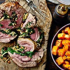 Roast shoulder of lamb with Moroccan spiced spinach stuffing.
