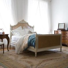 Juliet caned bed has a playful, romantic French feel inspired by the Rococo style of the 18th century