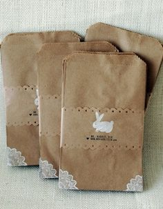 kraft bags with lace corners.