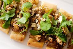 Pizza with caramelised onion, feta, rocket, and walnuts – Recipes – Bite