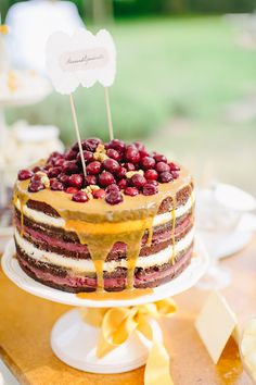 cranberry topped cake, photo by Carmen & Ingo http://ruffledblog.com/german-barn-wedding #weddingcake #cakes
