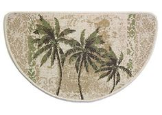 Accent your floors indoors or outdoors with this slice rug that features a tropical palm tree design that will complement your decor.  This mat provides a skid resistant backing. Measures 17.5 x 29.5.