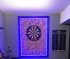 The hubby finally finished his latest ManCave project. It turned out amazing!! Wine cork dartboard with LED lights that change colours.