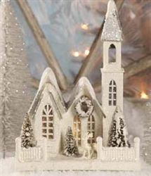"""Ivory Glitter Church   This gorgeous pressed paper church is a wonderful addition to any Christmas village. White with silver snow-draped roofs and fully glittered it includes bottle brush trees, wreaths, fences and reindeer figurine all sitting on a box style base. 10"""" x 17 3/4"""". Opening in back for lighting.  By Bethany Lowe"""