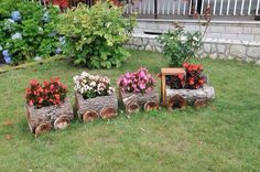 Train landscaping planter made with firewood logs.