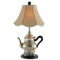 @Overstock.com - The Golden Teapot Table Lamp - Add a cute touch to your desk or a side table with one of these beautiful single-light gold table lamps. The elegant teapot used for the base gives the piece a whimsical appearance that is accented by the lined, scalloped beige shade.   http://www.overstock.com/Home-Garden/The-Golden-Teapot-Table-Lamp/6185596/product.html?CID=214117 $72.99