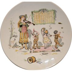 Wonderful French Faience Character / Story Plate  or Plaque ~ Woman Playing a Violin with Babies in Costumes Dancing~ Froment-Richard / Antoine-Albert Richard ~UTZSCHNEIDER & CO (Sarreguemines, France) – 1905-1910