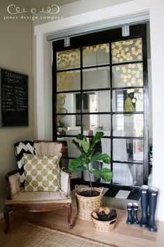 old window ~ use old large window as a room divider...creates definition / separate rooms without making a small room/space feel small and closed in
