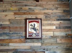 Our pallet wall with Shepard Fairey print.