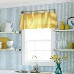 Blue kitchen Wall shelves tableware porcelain blue vase yellow flowers yellow curtains small window washbasin