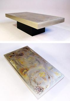 A coffee table from the 1970's with etched metal top.