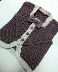 Kısa Kol Erkek Bebek Yeleği Yapılışı We are here with the short sleeve baby boy vest which is a very nice model. If you are looking for a vest model for baby boys, you can try this model. Knitting For Kids, Baby Knitting Patterns, Crochet For Kids, Crochet Baby, Crochet Bikini, Knit Crochet, Baby Boy Vest, Baby Boy Outfits, Baby Boys
