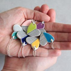My Monday crush: ceramic Jewelry by Isla Clay. I love the bright colors and playful patterns in these delightful handmade pieces! Earthenware Clay, Ceramic Clay, Porcelain Ceramics, Painted Porcelain, Porcelain Jewelry, Ceramic Jewelry, Polymer Clay Jewelry, Ceramic Necklace, Ceramic Pendant