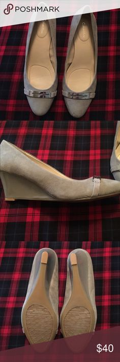 Calvin Klein Shoes Gorgeous Calvin Klein shoes! Soft grey color with silver detail. Brand new, never worn! Addition cushion inside for added comfort. Small gift included with every purchase  Calvin Klein Shoes Wedges
