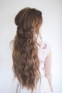 Mohawk Inspired Waves: Combine beach waves with pretty braids for an enchanted look that is great for boho brides. The middle braid is a uniquely gorgeous touch that gives this style a little something special.