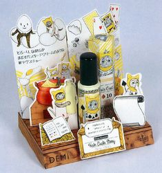 Alice in Wonderland style product display is too cute! Demi Cosmetics hair styling custard with illu. Shop Display Stands, Pos Display, Display Design, Booth Design, Product Display, Pos Design, Stand Design, Branding Design, Cosmetic Display