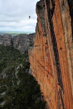 Wiz Fineron Taking the victory jump off Serpentine 29, 8a, 5.13b, Taipan Wall, Grampians, Australia photo: Chris Flowers