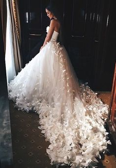 Designer wedding dresses with pretty flower motif embellishments are great for beach or outdoor weddings. A style like this can be easily recreated for you with any changes by our dress design firm. Get info on custom wedding dresses (and #replicas) when you visit www.dariuscordell.com