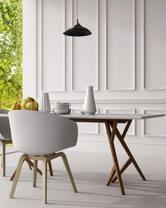 The Jonas Dining Table brings a modern twist to its Scandinavian design, featuring branchlike solid American Oak legs and a powdered coated MDF table top. Wood Table Legs, Dining Table Legs, A Table, Tulip Table, Mid Century Dining Table, Mid Century Modern Table, Midcentury Modern Dining Table, White Table Top, Dining Room Design