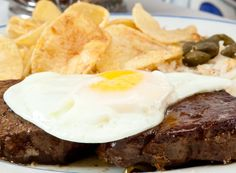 Bife com Ovo a Cavalo is one of the most traditional signature dishes in Portuguese cuisine.