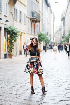 Aida Domenech is wearing a black crop top from Asos, tropical print skirt from Alice & Olivia, shoes from Nasty Gal and bag from Moschino