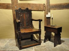ENGLISH RENAISSANCE GREAT-CHAIR. CIRCA 1560.    This important and remarkably well preserved chair reflects the meeting of earlier Tudor chair-making tradition with up-to-date Renaissance ornament popular in the mid-sixteenth century. The chair�s low and broad stature, nearly square ground plan, straight arms and twin, vertical back panel arrangement are common on English joined chairs before 1570.The simple and heavy columnar posts and the use of riven timber as the primary material.