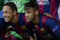 Barcelona's Brazilian forward Neymar da Silva Santos Junior (R) and Barcelona's Brazilian defender Adriano pose with their teammates before the UEFA Champions League football match FC Barcelona vs APOEL FC at the Camp Nou stadium in Barcelona on September 17, 2014.