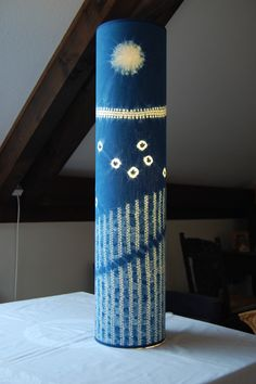 Shibori patterned indigo dyed lamp shade tubelight by Annabel Wilson.