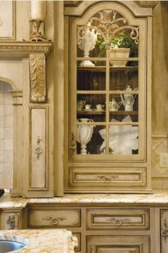 Countertop Curio Cabinetry & Venetian Hearth range hood design