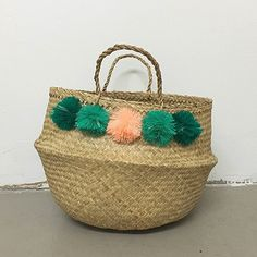 """handmade basket with colorful pompoms as shownapproximately 14"""" tall not including handlePlease allow approximately three weeks"""